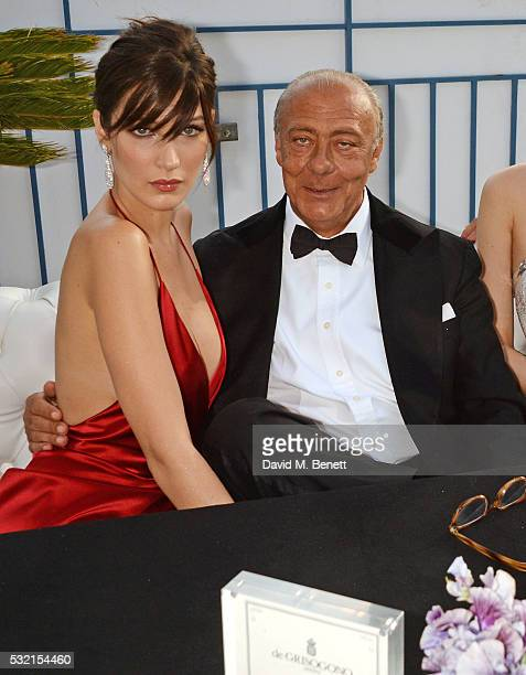 Bella Hadid and Fawaz Gruosi attend a performance by Seal at the de Grisogono showroom Terrace 'Les Oliviers' during the 69th Cannes Film Festival at...