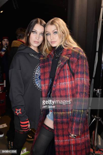Bella Hadid and Gigi Hadid backstage ahead of the Tommy Hilfiger TOMMYNOW Fall 2017 Show during London Fashion Week September 2017 at the Roundhouse...