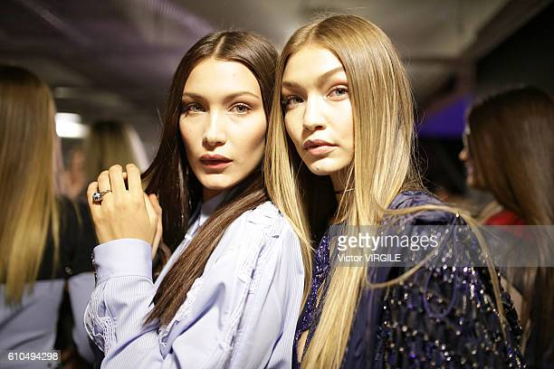 Bella Hadid and Gigi Hadid backstage at the Versace Ready to Wear show during Milan Fashion Week Spring/Summer 2017 on September 23 2016 in Milan...