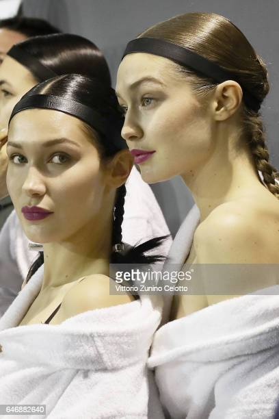 Bella Hadid and Gigi Hadid prepare backstage before the HM Studio show as part of the Paris Fashion Week on March 1 2017 in Paris France
