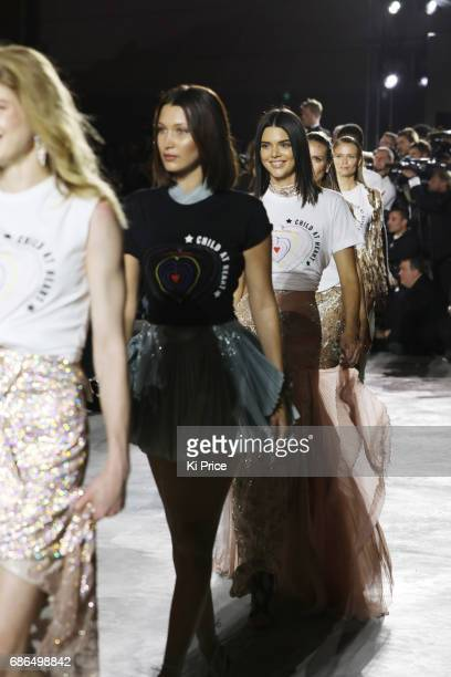 Bella Hadid and Kendall Jenner walk the runway at the Fashion for Relief event during the 70th annual Cannes Film Festival at Aeroport Cannes...
