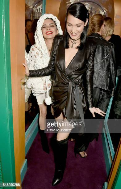 Bella Hadid and Kendall Jenner wearing Burberry Feb 2017 Couture cape at the LOVE and Burberry London Fashion Week Party at Annabel's celebrating...