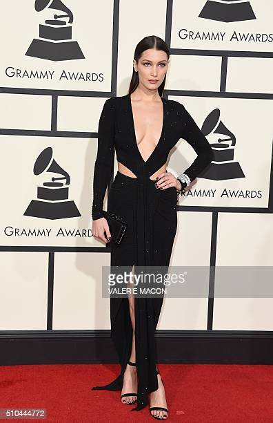 Bella Hadid arrives on the red carpet for the 58th Annual Grammy music Awards in Los Angeles February 15 2016 AFP PHOTO/ VALERIE MACON / AFP /...