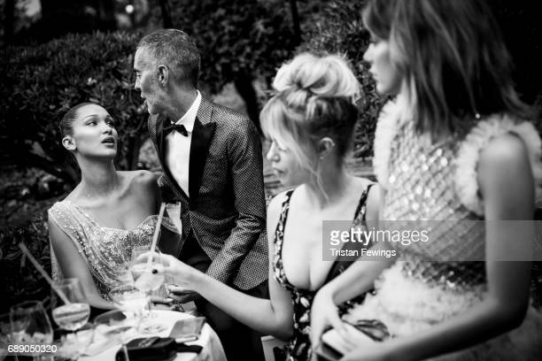 Bella Hadid Dan Caten Hailey Clauson and Camila Morrone attends the amfAR Gala Cannes 2017 at Hotel du CapEdenRoc on May 25 2017 in Cap d'Antibes...