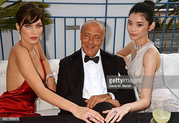 Bella Hadid Fawaz Gruosi and Ming Xi attend a performance by Seal at the de Grisogono showroom Terrace 'Les Oliviers' during the 69th Cannes Film...