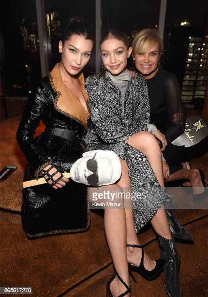 Bella Hadid Gigi Hadid and Yolanda Hadid attend V Magazine's intimate dinner in honor of Karl Lagerfeld at The Top of The Standard on October 23 2017...