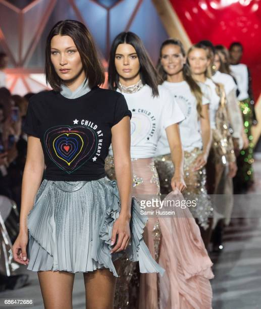 Bella Hadid Kendall Jenner and Heidi Klum walks the runway at the Fashion for Relief event during the 70th annual Cannes Film Festival at Aeroport...