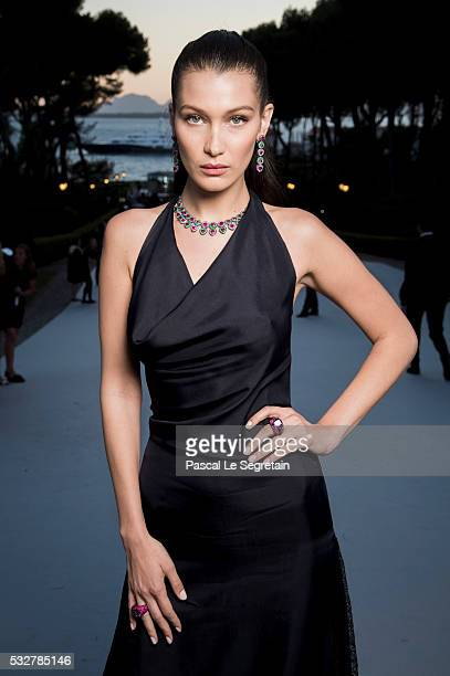 Bella Hadid poses for photographs at the amfAR's 23rd Cinema Against AIDS Gala at Hotel du CapEdenRoc on May 19 2016 in Cap d'Antibes France