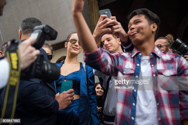 Bella Hadid takes a selfie with fans outside the Max Mara show during Milan Fashion Week Spring/Summer 2017 on September 22 2016 in Milan Italy