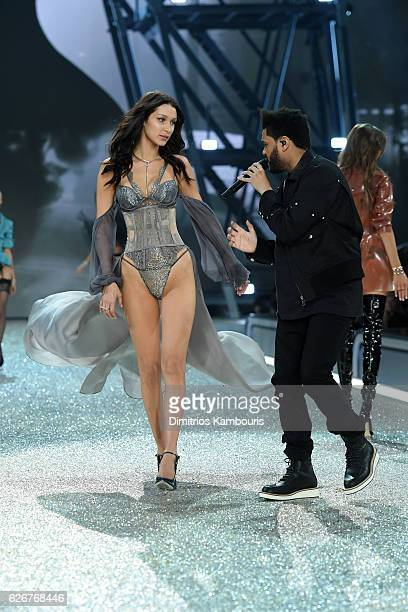 Bella Hadid walks the runway as The Weeknd performs during the 2016 Victoria's Secret Fashion Show on November 30 2016 in Paris France