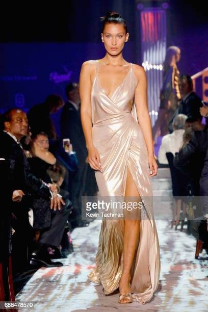 Bella Hadid walks the runway at the amfAR Gala Cannes 2017 at Hotel du CapEdenRoc on May 25 2017 in Cap d'Antibes France