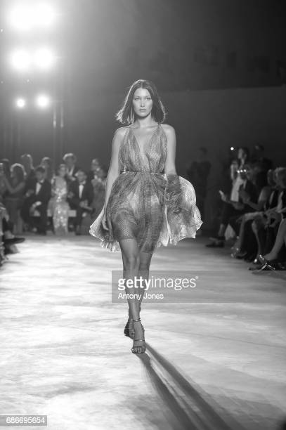 Bella Hadid walks the runway at the Fashion for Relief event during the 70th annual Cannes Film Festival at Aeroport Cannes Mandelieu on May 21 2017...
