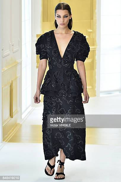 Bella Hadid walks the runway during the Christian Dior Haute Couture Fall/Winter 20162017 show as part of Paris Fashion Week on July 4 2016 in Paris...