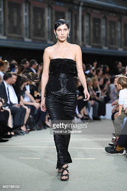 Bella Hadid walks the runway during the Givenchy Menswear Spring/Summer 2017 show as part of Paris Fashion Week on June 24 2016 in Paris France