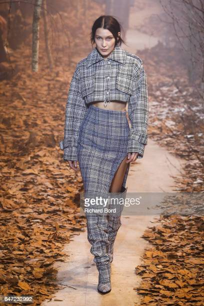 Bella Hadid walks the runway during the OffWhite show at Palais de Tokyo as part of the Paris Fashion Week Womenswear Fall/Winter 2017/2018 on March...