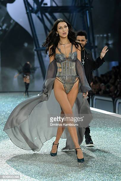 Bella Hadid walks the runway next to The Weeknd during the 2016 Victoria's Secret Fashion Show on November 30 2016 in Paris France