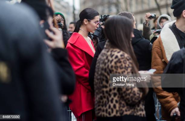 Bella Hadid wearing a red suit outside Lanvinon March 1 2017 in Paris France