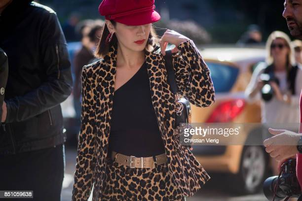 Bella Hadid wearing suit with leo print red flat cap is seen outside Max Mara during Milan Fashion Week Spring/Summer 2018 on September 21 2017 in...