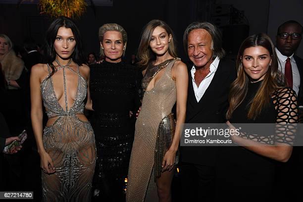 Bella Hadid Yolanda Foster Gigi Hadid Mohamed Hadid and Shiva Safai attend the Victoria's Secret After Party at the Grand Palais on November 30 2016...