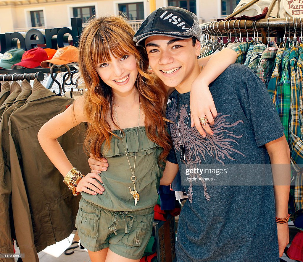 <a gi-track='captionPersonalityLinkClicked' href=/galleries/search?phrase=Bella+Thorne&family=editorial&specificpeople=5083663 ng-click='$event.stopPropagation()'>Bella Thorne</a> (L) and Adam Irigoyen pose with Superdry at the Kari Feinstein MTV Movie Awards Style Lounge held at Montage Beverly Hills on June 4, 2010 in Beverly Hills, California.
