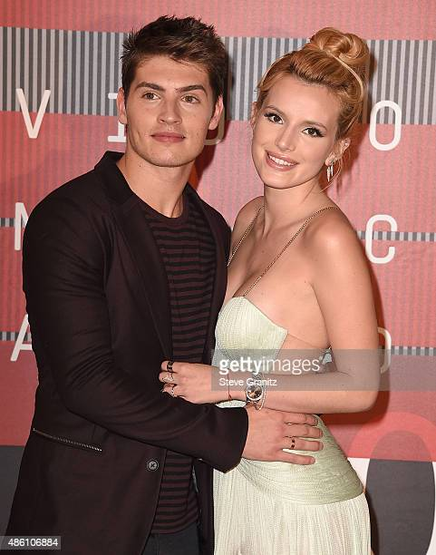 Bella Thorne and Gregg Sulkin arrives at the 2015 MTV Video Music Awards at Microsoft Theater on August 30 2015 in Los Angeles California