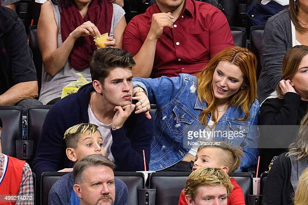 Bella Thorne and Gregg Sulkin attend a basketball game between the Minnesota Timberwolves and the Los Angeles Lakers at Staples Center on November 29...