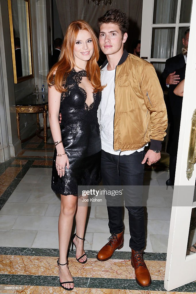 Bella Thorne (L) and Gregg Sulkin attend the Marchesa Spring 2016 fashion show during New York Fashion Week at St. Regis Hotel on September 16, 2015 in New York City.
