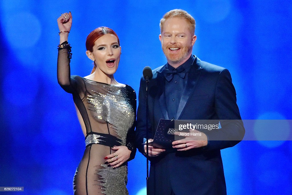 Bella Thorne and Jesse Tyler Ferguson speak onstage during the 22nd Annual Critics' Choice Awards at Barker Hangar on December 11, 2016 in Santa Monica, California.