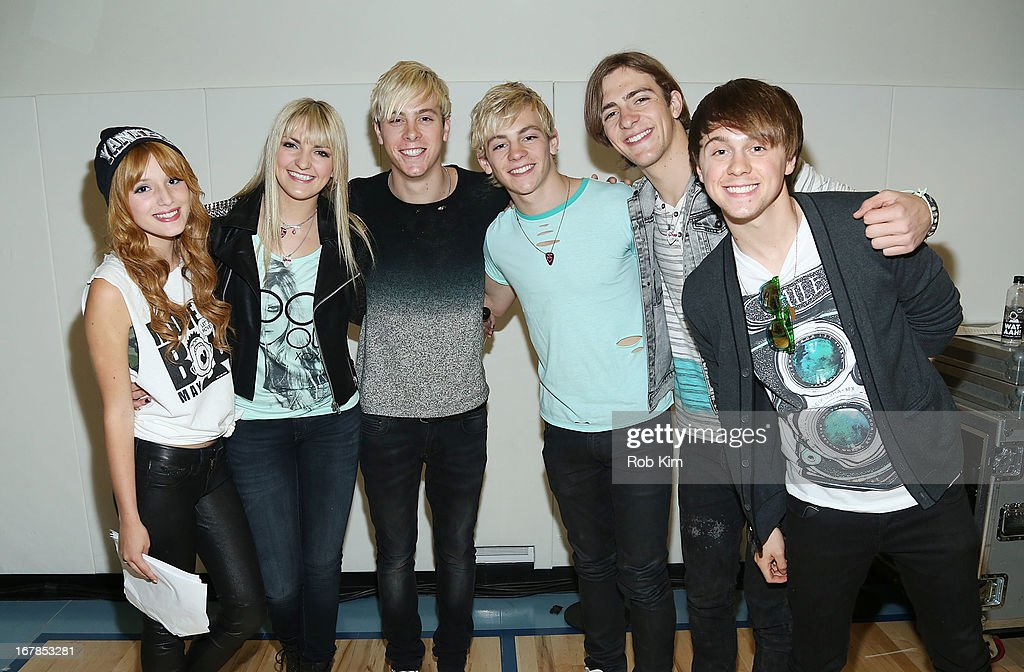 Bella Thorne (L) and members of R5 attend WAT-AAH! Foundation Move Your Body 2013 Flash Workout at The Avenues World School on May 1, 2013 in New York City.