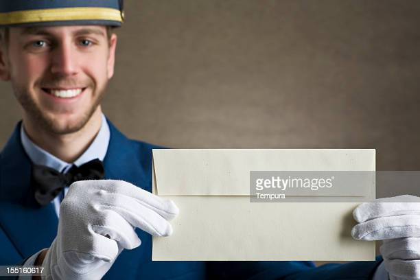 Bellboy holding an envelope as copy space.