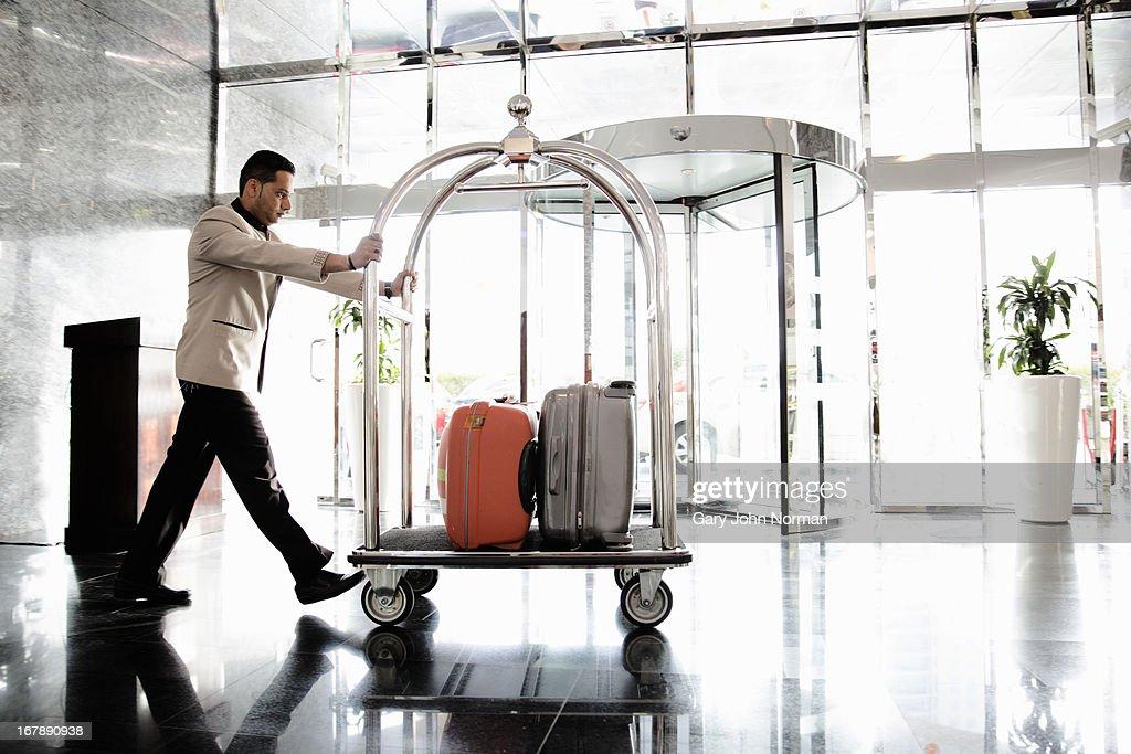 Bellboy pushing luggage trolley