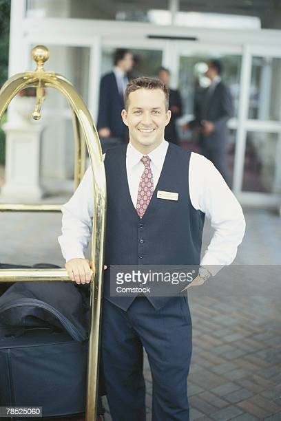Bellboy with luggage cart