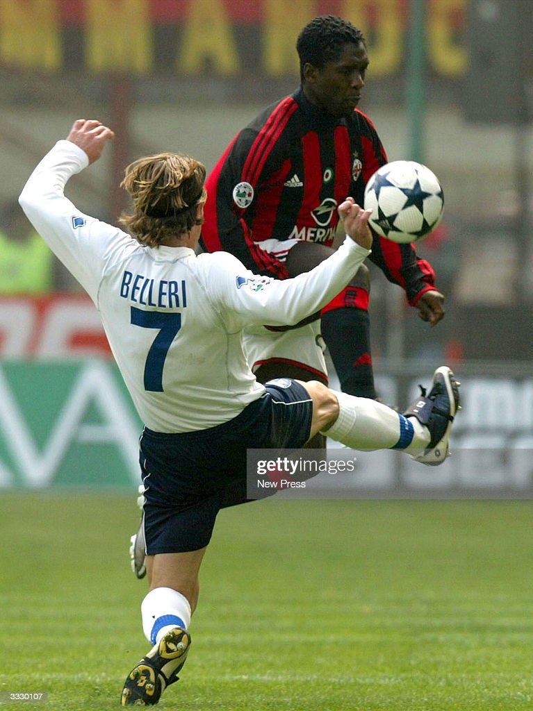 Belleri and Seedorf in action during the Serie A match between Milan and Empoli April 10, 2004 in Milan, Italy.