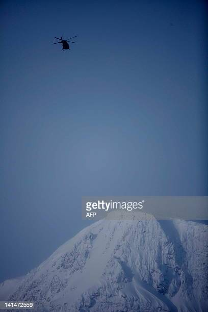 A Bellhelicopter takes off before daybreak on March 17 2012 from Kebnekaise to take part in a search and rescue operation near the Kebnekaise...