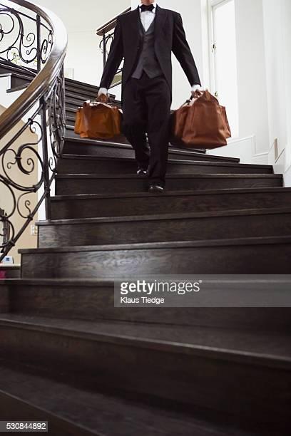 Bellhop descending staircase