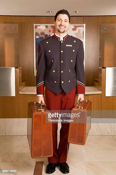 Bellhop holding luggage
