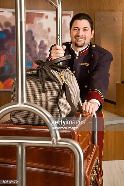 Bellhop pushing cart