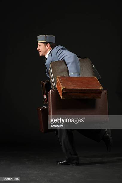 Bellhop running with suitcases