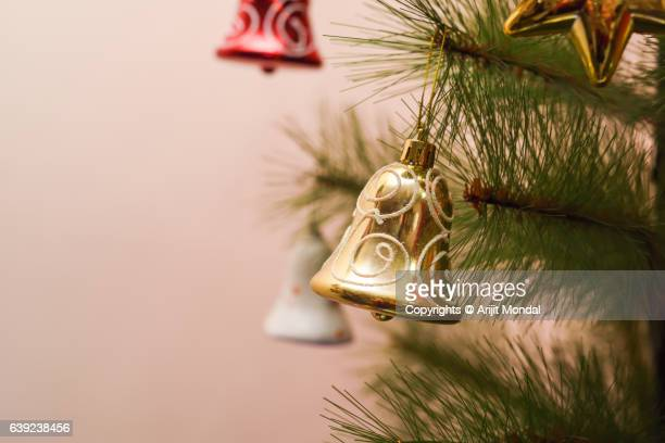 Bells Hanging On Christmas Tree with Copy Space
