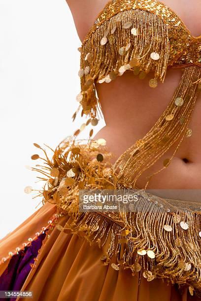 Belly dancer in golden dress