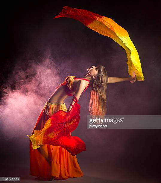 Belly dancer with colorful Fan Veils