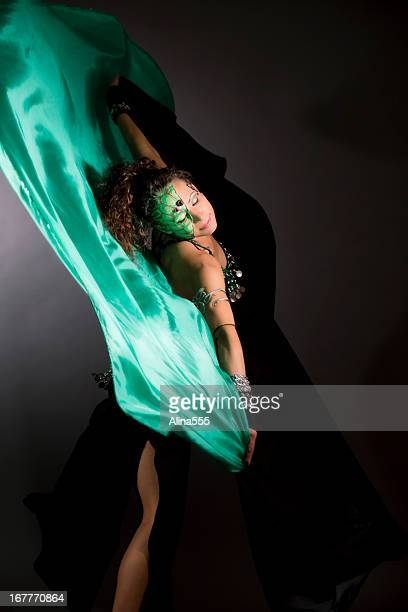 Belly dancer with stage makeup and silk scarves