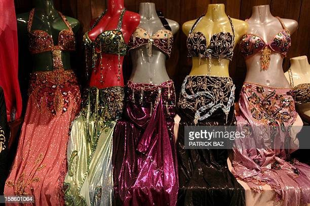 Belly dancing outfits are displayed at a dance school in the Egyptian capital Cairo on December 12 2012 This picture was taken during a belly dancing...