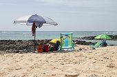 Sun parasol on sunny beach in El Cotillo, Fuerteventura