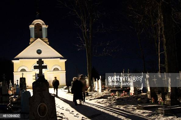 Belorussians prepare to celebrate the Orthodox Christmas in the village of Kevly some 140 km northwest of Minsk early on January 7 2015Orthodox...