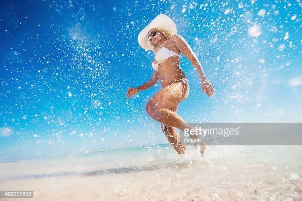 Below view of carefree woman having fun in the sea.