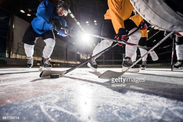 Below view of ice hockey players in action during the match.