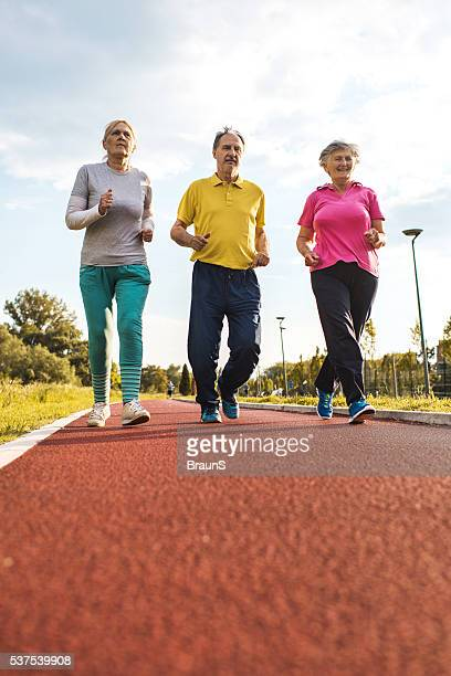 Below view of senior people jogging on running track.