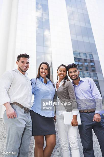 Below view of smiling business team outdoors.