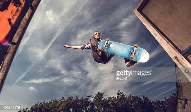 Below view of street skateboarder in action.